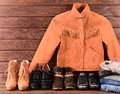 Women's clothing and accessories. Brown suede jacket, jeans, fou Royalty Free Stock Photo