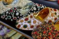 women& x27;s slippers decorated with semiprecious stones and beads on market in UAE