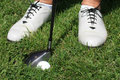 Womens golf shoes and golfball Stock Images