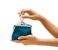 Womens hand throwing a coin one euro in the full purse Royalty Free Stock Photo