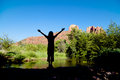 Wonder at cathedral rock a woman silhouetted with arms raised in near scenic sedona arizona Stock Photos
