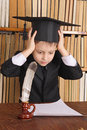 Wonder child as a professor with quill and paper in library Royalty Free Stock Photos