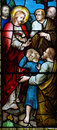 Wonder of jesus helping a child stained glass photo Stock Photos