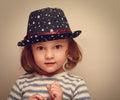 Wonder kid girl in trendy hat looking closeup vintage portrait Royalty Free Stock Photos