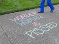 `Wonder Woman is Pissed` chalk on sidewalk Royalty Free Stock Photo