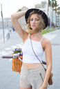 Wonderful female enjoying the summer vacation strolling in the streets Royalty Free Stock Photo