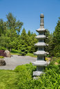 Wonderful japanese garden with a temple or tibetan stupa. Royalty Free Stock Photo