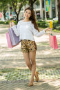 Wonderful shopping full length portrait of an attractive lady with bags outside Stock Photos