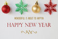 Wonderful is about to happen happy new year quotation on white background with ornaments Royalty Free Stock Image