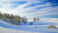 Wonderful winter landscape with beautiful clouds and shadows on snow Royalty Free Stock Images