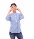 Wondering latin woman looking left up portrait of while standing on isolated white background copyspace Stock Images