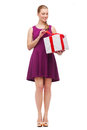 Wondering smiling girl with present box Royalty Free Stock Photo