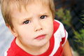 Wonderous eyes a young two year old looks at the viewer with a sense of wonder and curiousity in the Stock Photo