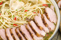 Wonton and duck noodle soup chinese with dumplings sliced breast Stock Photos