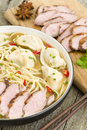 Wonton and duck noodle soup chinese with dumplings sliced breast Royalty Free Stock Photography