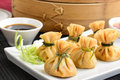 Wontons wonton oriental deep fried filled with prawn and spring onion served with dumpling and chili sauces Stock Photos