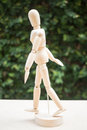 Wood artist mannequin pose walking on the table stock photo Stock Images
