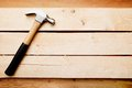 Wood background with a hammer Royalty Free Stock Photo