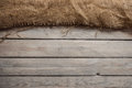 Wood background with hessian textile Royalty Free Stock Photo
