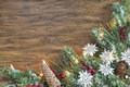 Wood background with a seasonal christmas holiday border wooden festive pine room for copy space Royalty Free Stock Image