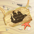 Wood banner with pirate ship over sand beach Royalty Free Stock Photography