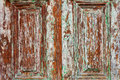 Wood barn door rich grain with peeling paint texture Royalty Free Stock Photography