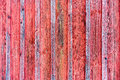 Wood barn wall with red peeling flaking color. Royalty Free Stock Photo