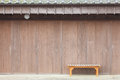 Wood bench in front of Old japanese shop house Royalty Free Stock Photo