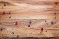 Wood board with berries and granola scattered with text space for in the middle Stock Photography