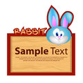 Wood board with rabbit for your design Royalty Free Stock Photo