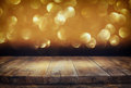 Wood boards and dark glitter bokeh lights background Royalty Free Stock Photo