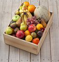 Wood box of fruit mixed fresh in a crate and background Stock Photo