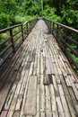 Wood bridge crossing the river in the rain forest Royalty Free Stock Photos
