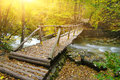Wood bridge over calm river Stock Image