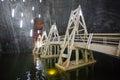 Wood bridge over underground lake in turda salt mine romania Royalty Free Stock Photo
