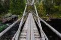 Wood bridge over the wild river Royalty Free Stock Photo
