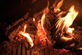 Wood burning in fire closeup of at night Stock Photos
