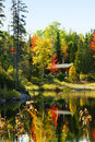 Wood cabin lake beautiful fall forest Stock Image