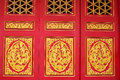Wood carved Chinese on red doors Royalty Free Stock Photo