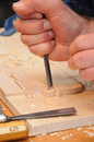 Wood carving closeup of home made with sharp gouge Royalty Free Stock Image