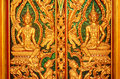 Wood carving temple door in thailand details of the wooden of the Royalty Free Stock Photo