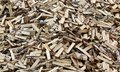 Wood chipped wood, background, texture. Pile of firewood. Royalty Free Stock Photo