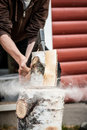 Wood chopping with hand axe Royalty Free Stock Photo