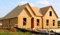 Wood Covered Frame of a Suburban Home Under Construction Royalty Free Stock Photo