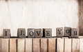 Wood cube make message i love you spelled out on a row of lettered wooden blocks with retro or vintage appearance Stock Photography