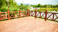 Wood deck wooden patio outdoor corner of empty exterior with balustrade by lake in park Stock Photo
