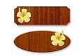 Wood decorated with frangipani flowers Royalty Free Stock Photography