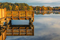 Wood Dock over pond or lake in fall autumn in Connecticut USA Royalty Free Stock Photo