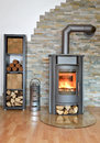 Wood fired stove with fire fire irons and briquettes from bark Stock Photos
