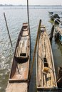 Wood Fishing Boat or Rowboat on Swamp with Wood Boat Pole Portrait Royalty Free Stock Photo
